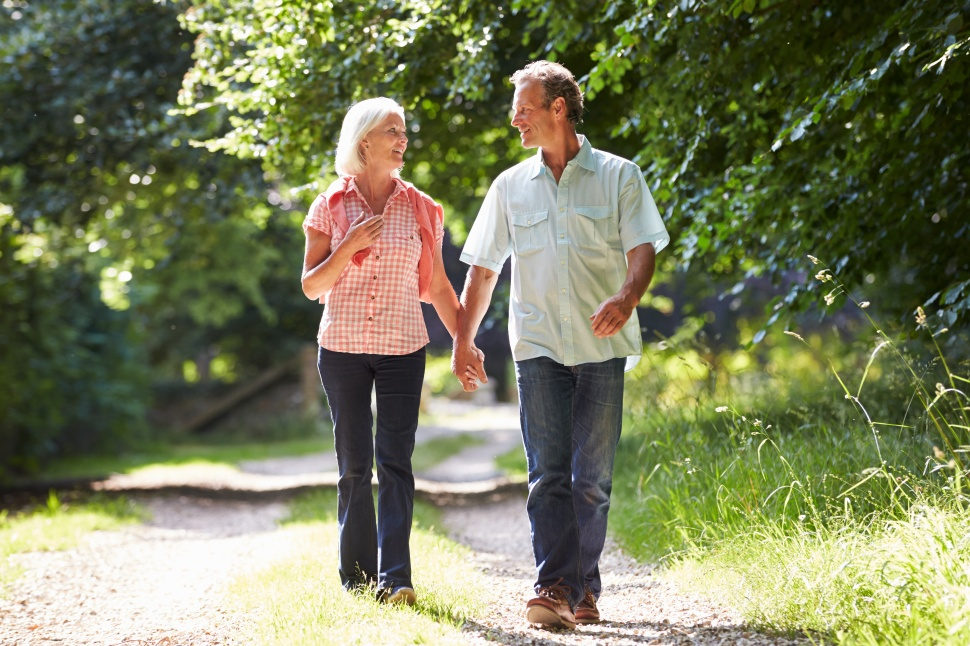 Romantic Middle Aged Couple Walking Along Countryside Path